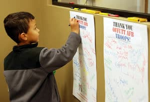 Signing cards for Offutt troops